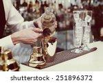 bartender is pouring liquor in... | Shutterstock . vector #251896372
