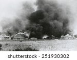 Small photo of Village on the Densa River in flames during the Nazi invasion of the Soviet Union. August 1941, World War 2.