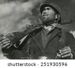 Small photo of On the Guadalajara front, a soldier of the Spanish Republican (loyalist) army looks out for airplanes. April 1937. Spanish Civil War, 1936-1939.