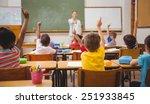 Pupils raising their hands...