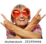 senior woman wearing big...