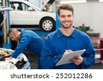 smiling mechanic writing on... | Shutterstock . vector #252012286