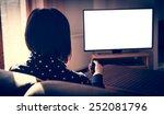 woman watching tv  | Shutterstock . vector #252081796