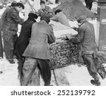 Small photo of Burying Al Capone. Workmen at Mt. Olivet Cemetery in Chicago moving the vault with Al Capone's body. Feb. 6, 1947.
