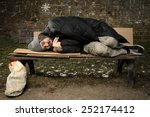 Homeless Man Sleeping On Bench...