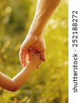 a parent holds the hand of a... | Shutterstock . vector #252188272