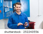 mechanic using a tablet pc at... | Shutterstock . vector #252243556