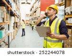 warehouse worker talking on the ... | Shutterstock . vector #252244078
