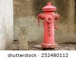 A Weathered Red Fire Hydrant...