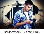 handsome photographer with... | Shutterstock . vector #252544408