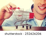 man with a small shopping... | Shutterstock . vector #252626206