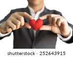 Businessman Giving A Red Heart...