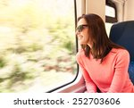 woman traveling on a train | Shutterstock . vector #252703606