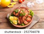 tasty baked fish on plate on...   Shutterstock . vector #252706078