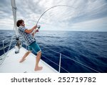 Young Man Fishing In Open Sea...