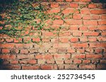 Leaves On Brick Wall For...