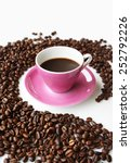 Pink coffee cup in a circle of coffee beans in perspective - stock photo