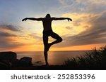 yogi meditating at sunset on... | Shutterstock . vector #252853396