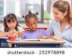 happy teacher in elementary... | Shutterstock . vector #252978898