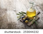 olive oil and olive branch on... | Shutterstock . vector #253044232