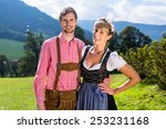 couple in tracht standing on... | Shutterstock . vector #253231168