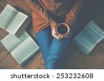 girl having a break with cup of ... | Shutterstock . vector #253232608