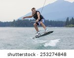 Man Wakeboarding On A Beautifu...