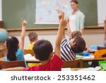 pupils raising hand during... | Shutterstock . vector #253351462
