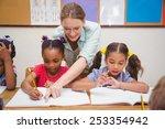 pretty teacher helping pupil in ... | Shutterstock . vector #253354942