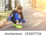 young sporty woman doing up her ... | Shutterstock . vector #253357726