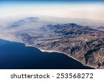 airview of the desert and sea... | Shutterstock . vector #253568272