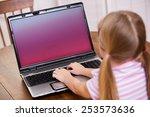 Computer  Young Girl Uses...