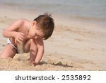 the boy plays sand on seacoast | Shutterstock . vector #2535892