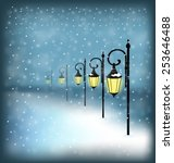 lanterns stand in snowfall on... | Shutterstock .eps vector #253646488