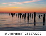 Old Wooden Pier In Harbor At...
