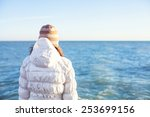 a young girl stand alone on the ... | Shutterstock . vector #253699156