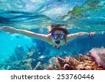 young women at snorkeling in... | Shutterstock . vector #253760446