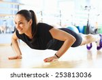 young woman doing push ups in... | Shutterstock . vector #253813036
