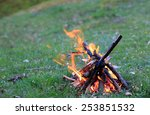 small campfire on green meadow | Shutterstock . vector #253851532
