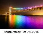Rainbow lights on Akashi Ohashi (Pearl Bridge) in Kobe, Japan. - stock photo