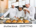team of bakers working at... | Shutterstock . vector #253977745