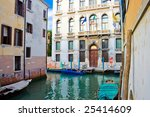 Nice venetian canal and old buildings, Italy - stock photo