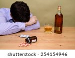 depressed man drinking alcohol...