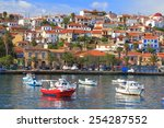 Traditional Town And Harbor...