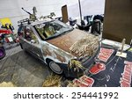 Small photo of TORINO, ITALY - FEBRUARY 15, 2015: Vintage custom Fiat Punto in Rat-style or Rat-Rod. It's a new generation of tuning, usually crummy looking exterior with rust colored parts on February 15, 2015