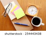 note book on wooden table with... | Shutterstock . vector #254443438