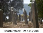 Small photo of World Heritage Site of former Port Arthur Penal Settlement on Tasmania, Australia, with ruins of prison and other buildings, with view over harbour, blurred background and copy space.