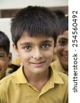 indian boy smiling in class | Shutterstock . vector #254560492