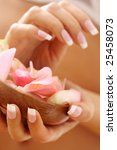 Beautiful hands with French manicure nails - stock photo