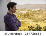 attractive young man standing...   Shutterstock . vector #254726656